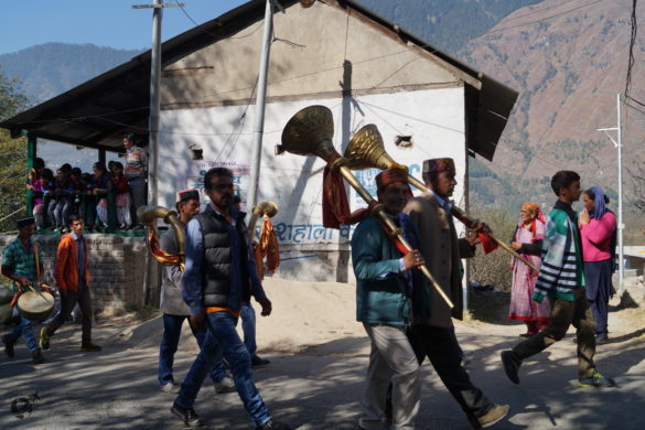 A religious procession on its way to a neighbouring village